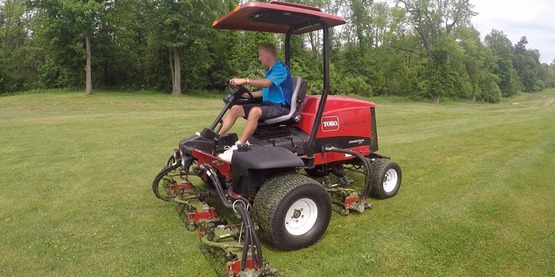 Photo of John Lawton mowing #18 fairway