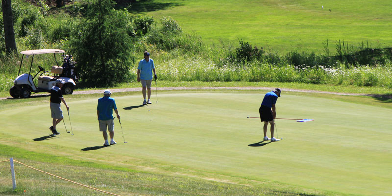 Photos of four golfers playing in league on hole #10 at Tamarack Golf Club.