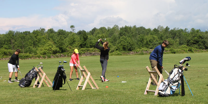 Photo of golf lessons on the range.